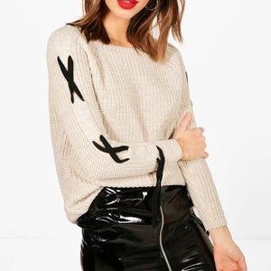 Beige sweater with black string lace up detail